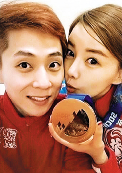 Viktor Ahn (left) poses with girlfriend Woo Na-ri in this photo posted on his Instagram account.
