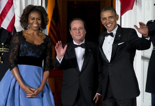 First lady Michelle Obama and President Barack Obama welcome French President François Hollande for a State Dinner at the White House on Feb. 11, 2014. /AP