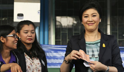 Thai Prime Minister and Pheu Thai party leader Yingluck Shinawatra poses before casting her ballot in Bangkok on Feb. 2, 2014. /AP