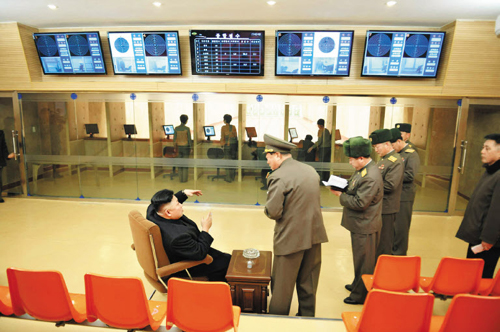 In this photo published by the official Rodong Sinmun daily on Wednesday, North Korean leader Kim Jong-un inspects a gun factory and a firing range.