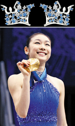 Kim Yu-na, wearing crown earrings by J.Estina, poses on the podium after winning the gold medal in the womens figure skating competition at the Vancouver Olympics on Feb. 25, 2010. /AP-Newsis