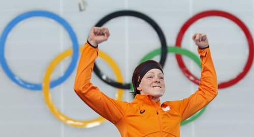 Gold medalist Jorien ter Mors of the Netherlands jumps in celebration during the flower ceremony for the womens 1,500-m speedskating race at the Adler Arena Skating Center during the 2014 Winter Olympics in Sochi, Russia on Feb. 16, 2014. /AP