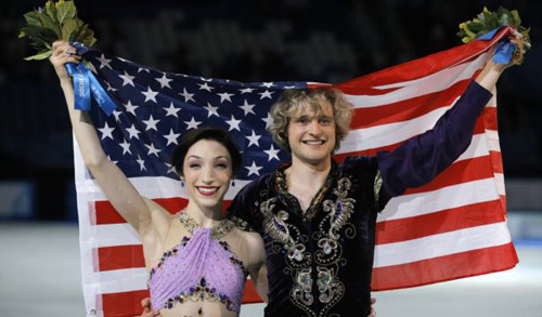 Meryl Davis and Charlie White of the U.S. pose for photographers after placing first in the Olympic ice dance free dance figure skating finals in Sochi on Feb. 17, 2014. /AP