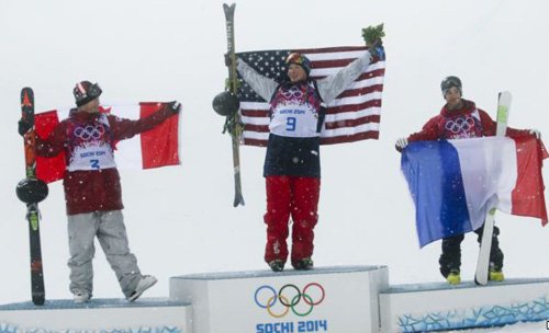 Canadas second placed Mike Riddle, first placed David Wise of the U.S. and Frances third placed Kevin Rolland (from left) celebrate on the podium after the mens freestyle skiing halfpipe finals at the 2014 Sochi Winter Olympics in Rosa Khutor, Russia on Tuesday. /Reuters