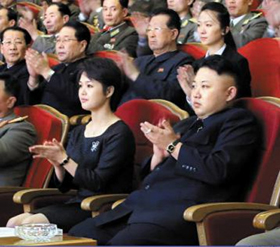 In this photo published by the official Rodong Sinmun daily on Tuesday, North Korean leader Kim Jong-un and his wife Ri Sol-ju clap at an event to celebrate his late fathers birthday. They are wearing watches by Swiss luxury brand Movado.