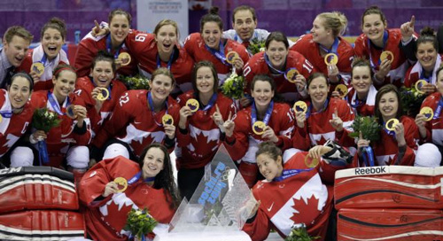 Team Canada gathers for a group photo after beating the U.S. 3-2 in overtime of the gold medal womens ice hockey game at the 2014 Winter Olympics in Sochi, Russia on Feb. 19, 2014. /AP