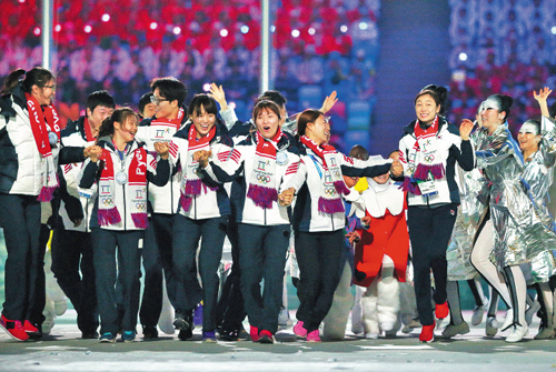 Korean athletes celebrate during the closing ceremony of the Sochi 2014 Winter Olympics in Russia on Sunday. /Getty Images