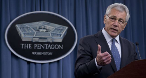 Defense Secretary Chuck Hagel briefs reporters at the Pentagon on Feb. 24, 2014. /AP