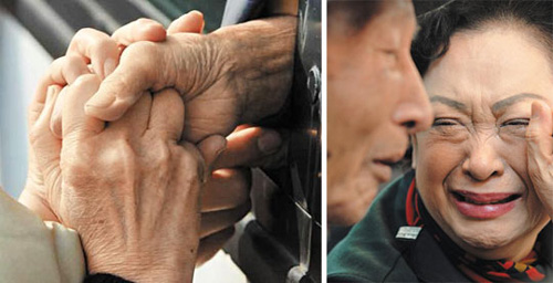 Left: Members of a family hold hands during a reunion at the Mt. Kumgang resort on Tuesday.; Right: A South Korean daughter cries looking at her North Korean father during a reunion at the Mt. Kumgang resort on Tuesday. /Newsis