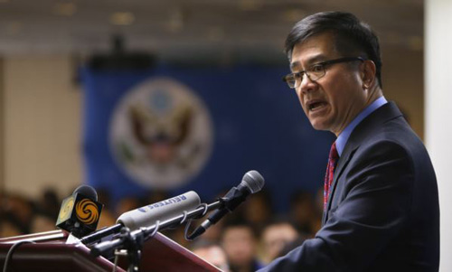 U.S. Ambassador Gary Locke delivers a farewell speech at Beijing American Center in Beijing on Feb. 26, 2014. /Reuters