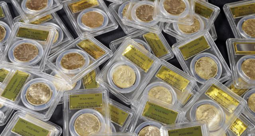 Some of 1,427 Gold-Rush era U.S. gold coins are displayed at Professional Coin Grading Service in Santa Ana, California, Tuesday on Feb. 25, 2014. /AP