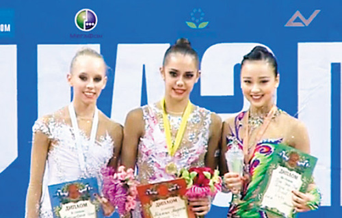 In this video grab, Son Yeon-jae (left) poses with Margarita Mamun (center) and Yana Kudryavtseva on the podium after the hoop event at the Moscow Grand Prix on Sunday.