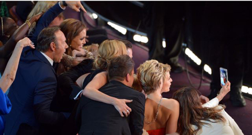 Kevin Spacey, from left, Angelina Jolie, Julia Roberts, Brad Pitt, Jennifer Lawrence, Ellen DeGeneres and Jared Leto join other celebrities for a