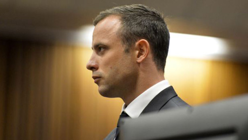 Olympic and Paralympic track star Oscar Pistorius stands in the dock during his trial at the North Gauteng High Court in Pretoria, South Africa on March 3, 2014. /Reuters