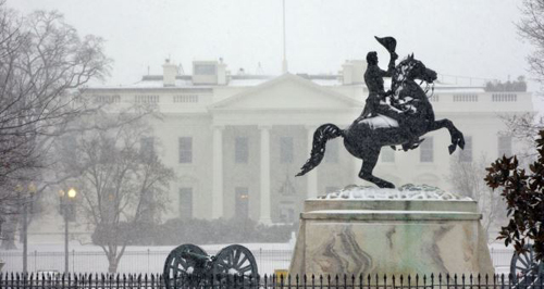 Snow falls at the White House after a winter weather prompted schools and the federal government to close in Washington, D.C. on March 3, 2014. /AP