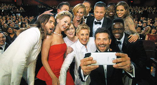 In this screen grab, the host of this years Academy Awards Ellen DeGeneres joins other celebrities such as Angelina Jolie, Julia Roberts, Brad Pitt and Kevin Spacey for a selfie during the Oscars at the Dolby Theatre   Dolby Theatre in Hollywood in Los Angles, California on Sunday.