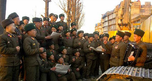 North Korean soldiers sing a propaganda song in this photo published by the official Rodong Sinmun daily on Dec. 21, 2013, some days after the execution of leader Kim Jong-uns uncle Jang Song-taek.