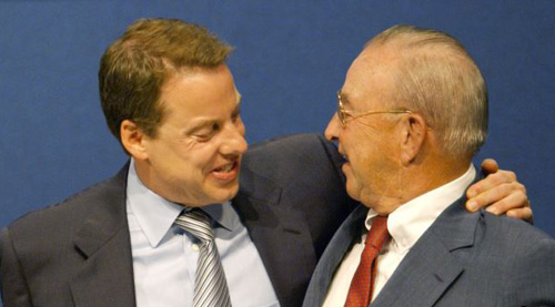 Ford Motor Company Chairman William Clay Ford Jr. (left) hugs his father, William Clay Ford Sr., on June 16, 2003, in Dearborn, Michigan. The year 2003 marked the 100th anniversary of the companys founding. /Reuters
