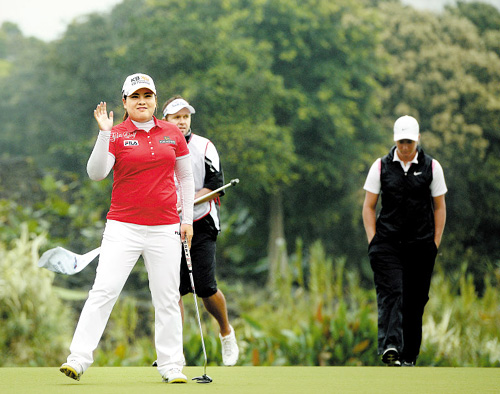 Park In-bee celebrates on Sunday during the final round of the World Ladies Championship on the Blackstone Course of the Mission Hills Resort Haikou on Chinas Hainan Island. /Courtesy of Mission Hills