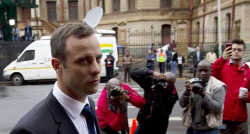 Oscar Pistorius arrives at the high court in Pretoria, South Africa on March 12, 2014. /AP