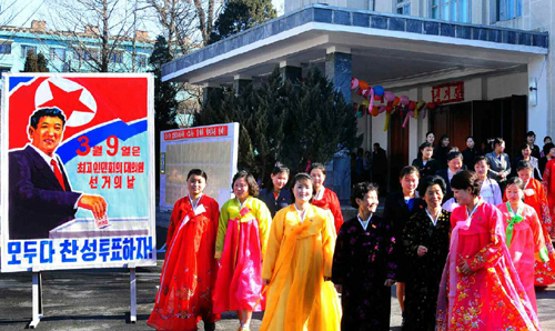 In this picture released by the Rodong Sinmun on Monday, people leave a polling station on March 9.