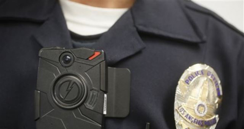 Los Angeles Police officer demonstrates on-body camera for media in Los Angeles, California. /AP