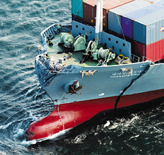 The Korean-registered Pegasus Prime is anchored at sea off Miura, Kanagawa Prefecture in Japan on Tuesday after being damaged in  a collision with a Panamanian ship. /Courtesy of Mainichi Shimbun