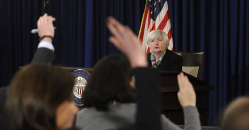 Federal Reserve Chair Janet Yellen participates in her first news conference at the Federal Reserve in Washington on March 19, 2014. /AP