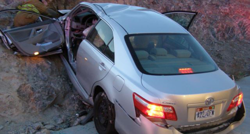 In this photo released by the Utah Highway Patrol, a Toyota Camry is shown after it crashed as it exited Interstate 80 in Wendover, Utah. /AP