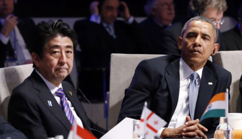 Japanese Prime Minister Shinzo Abe and U.S. President Barack Obama attend the opening session of the Nuclear Security Summit in the Hague on March 24, 2014. /AFP