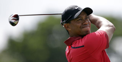 Tiger Woods hits from the third tee during the final round of the Cadillac Championship golf tournament in Doral, Florida on March 9, 2014. /AP