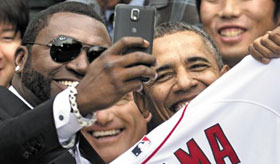 Boston Red Sox player David Ortiz (left) takes a selfie with President Barack Obama at the White House in Washington on April 1, 2014. /AP-Newsis