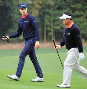 Choi Kyung-ju and Lee Chang-woo walk during a practice round prior to the start of the 2014 Masters Tournament at Augusta National Golf Club in Augusta, Georgia on Monday. /Getty Images