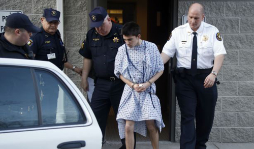Alex Hribal, the suspect in the stabbings at the Franklin Regional High School near Pittsburgh, is taken from a district magistrate in Export, Pennsylvania on April 9, 2014. /AP