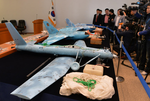 Three small unmanned aerial vehicles that crashed in Paju, Gyeonggi Province, on Baeknyeong Island, and in Samcheok, Gangwon Province are on display at the Agency for Defense Development in Daejeon on Friday.