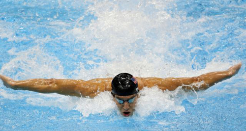 United States Michael Phelps swims in the mens 4 X 100-m medley relay at the Aquatics Center in the Olympic Park during the 2012 Summer Olympics in London. /AP