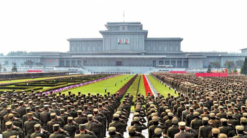 North Korean troops pledge allegiance to leader Kim Jong-un in Pyongyang on Sunday to mark the second anniversary of his election as chairman of the National Defense Commission in this photo from the official Rodong Sinmun.