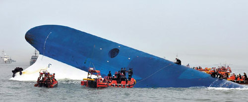 The ferry Sewol is almost submerged in the waters off Jindo, South Jeolla Province on Wednesday. /Newsis