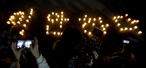 A candlelight vigil for the victims of the Sewol ferry disaster forms the word
