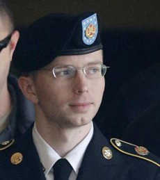 Army Pfc. Bradley Manning is escorted to a security vehicle outside a courthouse in Fort Meade, Maryland after a hearing in his court martial on Aug. 20, 2013. /AP