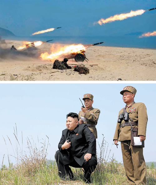 North Korean leader Kim Jong-un inspects a multiple-rocket launching drill at an army unit in these undated photos published by the Rodong Sinmun on Thursday.
