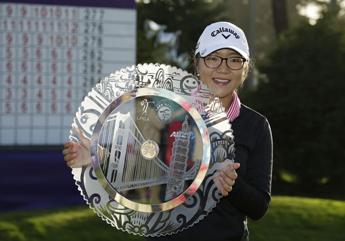 Lydia Ko poses with her trophy after winning the Swinging Skirts LPGA Classic at the Lake Merced Golf Club in Daly City, California on Sunday. /AP-Newsis