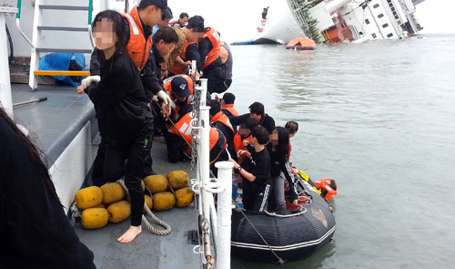 Passengers escape the sinking ferry Sewol to board a rescue boat on April 16.