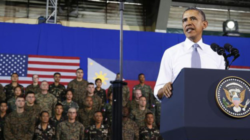 President Barack Obama speaks to military troops at the Fort Bonifacio Gymnasium in Manila on April 29, 2014. /Reuters