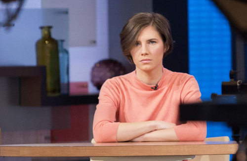 Amanda Knox sits alone before being interviewed on the set of ABCs