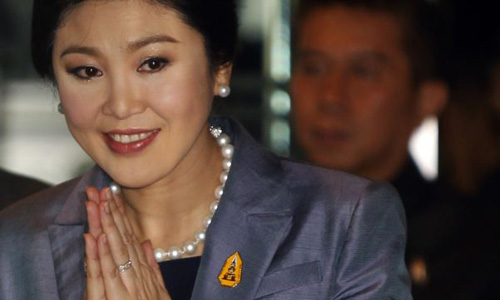Yingluck Shinawatra arrives at the Constitution Court in Bangkok on May 6, 2014. /Reuters