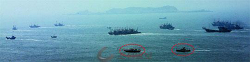Patrol ships (in red circle) crack down on illegal Chinese fishing in the waters around Yeonpyeong Island off the west coast on May 2.