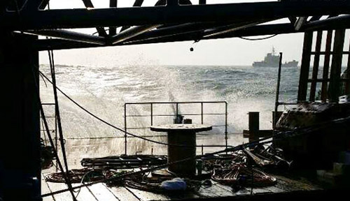 Waves hit a barge at anchor near the site of the ferry disaster in Jindo, South Jeolla Province on Sunday. /Newsis
