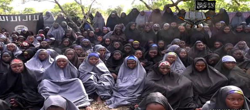 A video from Boko Haram claims to show the abducted Nigerian schoolgirls wearing full-length hijabs and praying in an undisclosed location in a screengrab taken May 12, 2014. /AFP