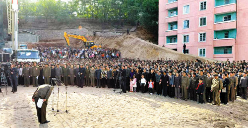 A North Korean official bows in apology over the collapse of an apartment building in Pyongyang, in this picture released by the official Rodong Sinmun daily on Sunday.